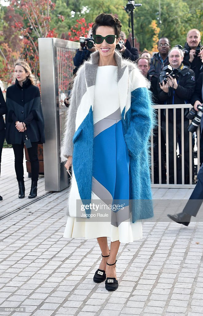 Farida Khelfa arrives at the Louis Vuitton Fashion Show during the Paris Fashion Week S/S 2016 Day Nine on October 7 2015 in Paris France
