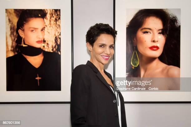 Farida Khelfa poses in front of a picture of her during the Simon Bocanegra and Philippe Morillon Exhibition at la Galerie Du passage Pierre Passebon...