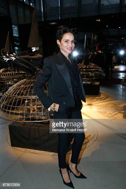 Farida Khelfa poses in front the dress 'Farida' work of JeanPaul Goude during the 'Societe des Amis du Musee d'Art Moderne du Centre Pompidou' Dinner...