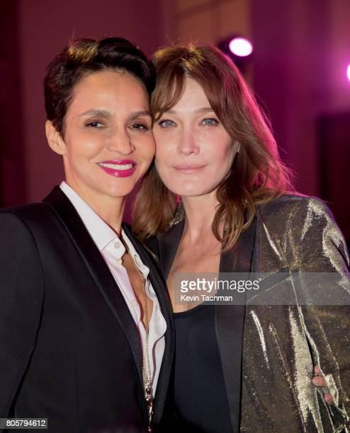 Farida Khelfa Seydoux and Carla Bruni attend the amfAR Paris Dinner at Le Petit Palais on July 2 2017 in Paris France