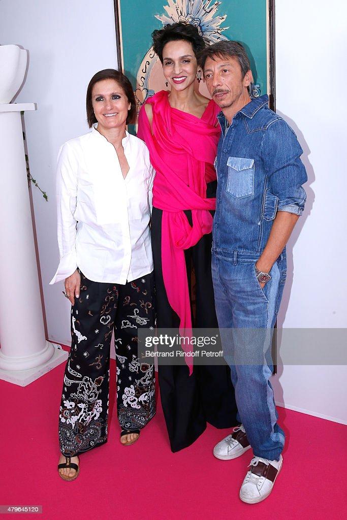 Farida Khelfa Seydoux standing between Fashion designers of Valentino Maria Grazia Chiuri and Pierpaolo Piccioli attend the Schiaparelli show as part...