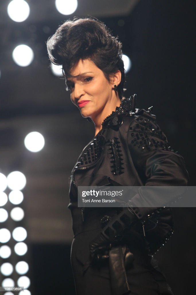 Farida Khelfa walks the runway during the JeanPaul Gaultier show as part of the Paris Haute Couture Fashion Week Spring/Summer 2011 at Atelier...