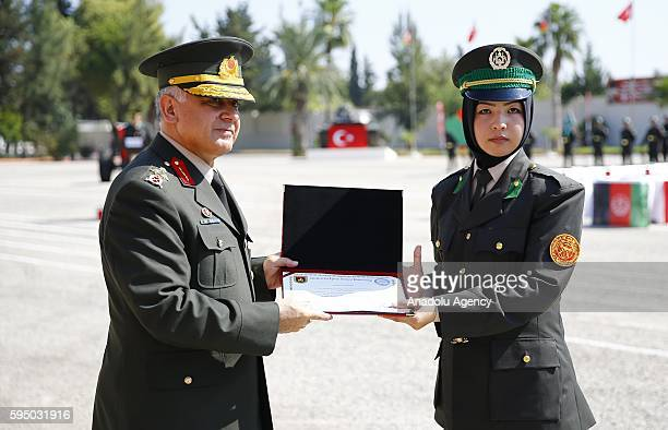 Farida Mirzad the second of the course received her graduation certificate and gift from the Commander of Land Forces Training and Doctrine Command...