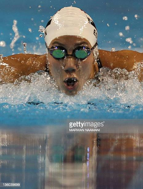 Farida Osman of Egypt competes in the women's 100m butterfly at the 2011 Arab Games in the Qatari capital Doha on December 17 2011 Osman of Egypt won...