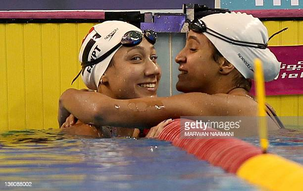Farida Osman of Egypt receives congratulations from her compatriot Hania Moro after winning the gold medal at the women's 50m backstroke event during...