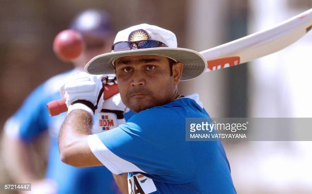 Indian batsman Virender Sehwag bats in the nets during a practice session at the Nahar Singh Cricket Stadium in Faridabad some 30 kms east of New...