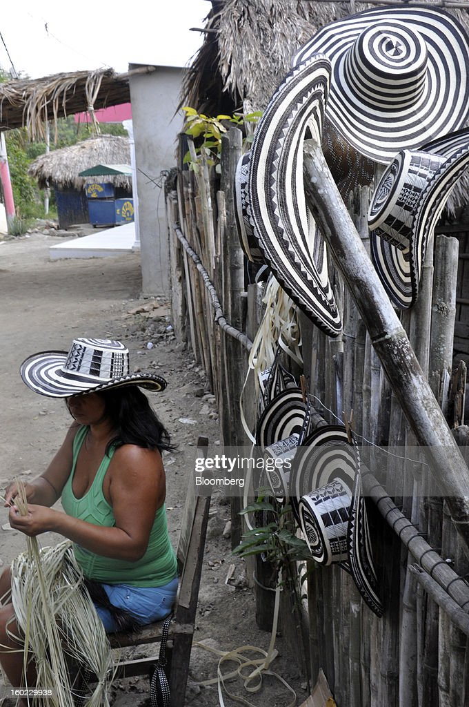 Faride Velasquez Morales makes a sombrero vueltiao, as the iconic woven hats are known, in the village of Tuchin, Colombia, on Saturday, Jan. 19, 2013. Chinese-made imitations of the hats sell for half the $20 price of the least expensive originals. In response to plunging sales by artisans who spend up to 15 days cutting, sun-drying and braiding cane leaves to make a single hat, the government is rushing to protect one of the nation's symbols and ban plastic, machine-made rip-offs. Photographer: Joshua Goodman/Bloomberg via Getty Images