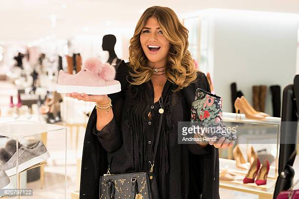 Farina Opoku aka Novalanalove poses with Sam Edelman shoes during the opening of the 'Dream Concept' floor at Galeria Kaufhof on November 2 2016 in...