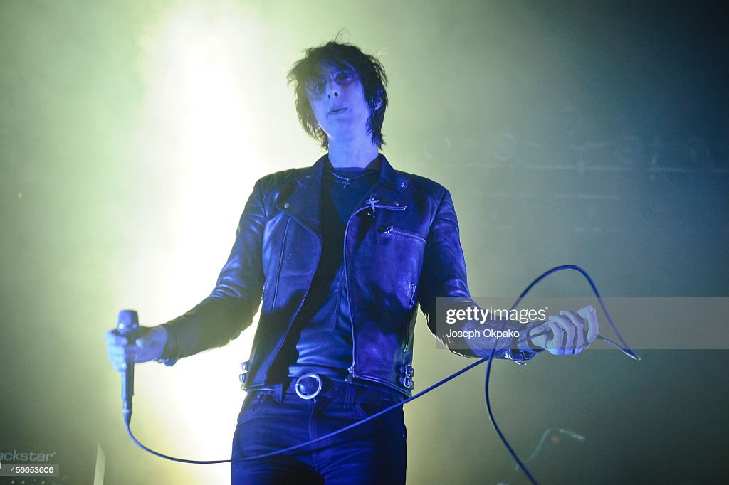 Faris Badwan of The Horrors performs on stage at the Troxy on October 4 2014 in London United Kingdom