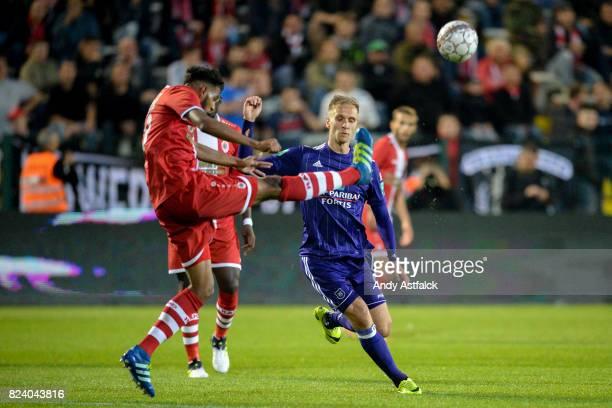 ANTWERP BELGIUM JULY Faris Haroun from Antwerp clears the ball from Lukasz Teodorczyk from Anderlecht during the Jupiler League match between Royal...