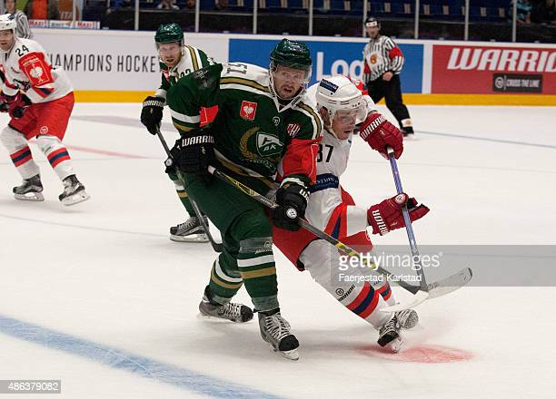 Farjestad player Rickard Wallin fights for the space with Pardubice player Petr Sykora during the Champions Hockey League group stage game between...