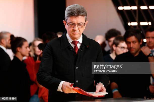 Farleft coalition La France insoumise JeanLuc Melenchon waits before taking part in a debate organised by the French private TV channel TF1 between...