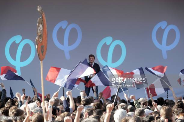 Farleft opposition 'France Insoumise' party's leader JeanLuc Melenchon delivers a speech at the end of a demonstration against the government's...