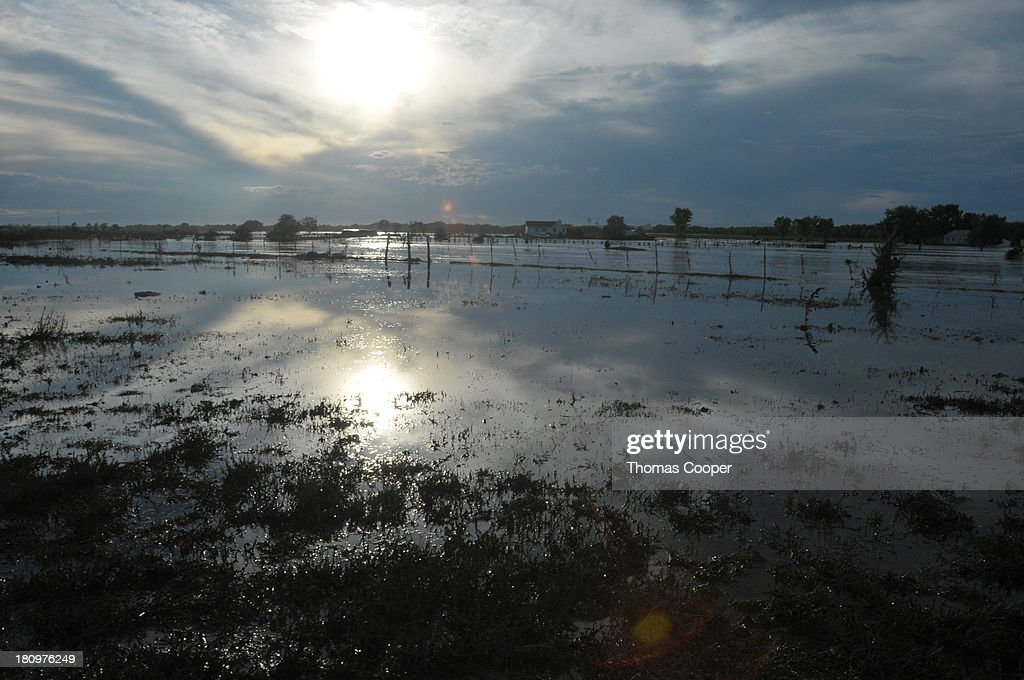 A farm field is shown inundated by flood waters September 17, 2013 near Evans, in eastern Colorado. Even as flooding subsides, many in the hardest hit areas of the state remain stranded by washed out roads and rushing creeks and without water and power.