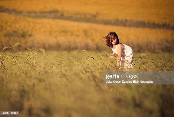 Farm girl in windy grass