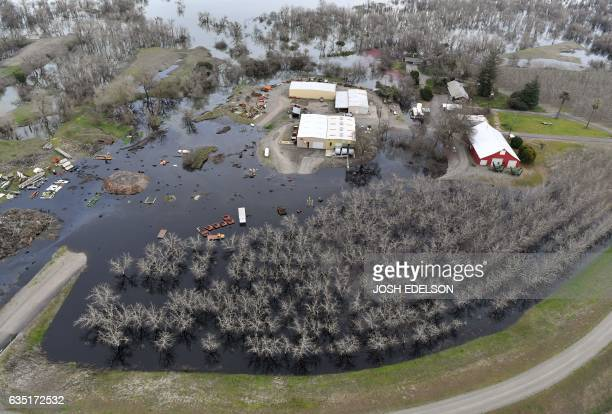A farm is seen partially submerged in flood water near Oroville California on February 13 2017 Almost 200000 people were under evacuation orders in...