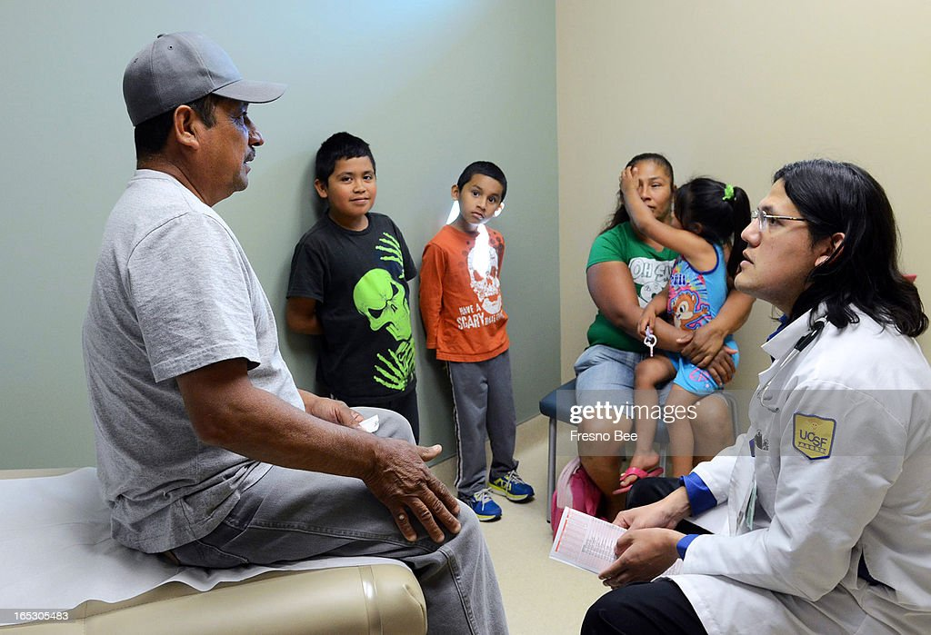 Farm laborer Javier Carreon talks to Dr. Luis Martinez during an exam at Clinica Sierra Vista in Fresno, California. Carreon is one of the many undocumented immigrants who delay care because they are poor, uninsured and in the country illegally.