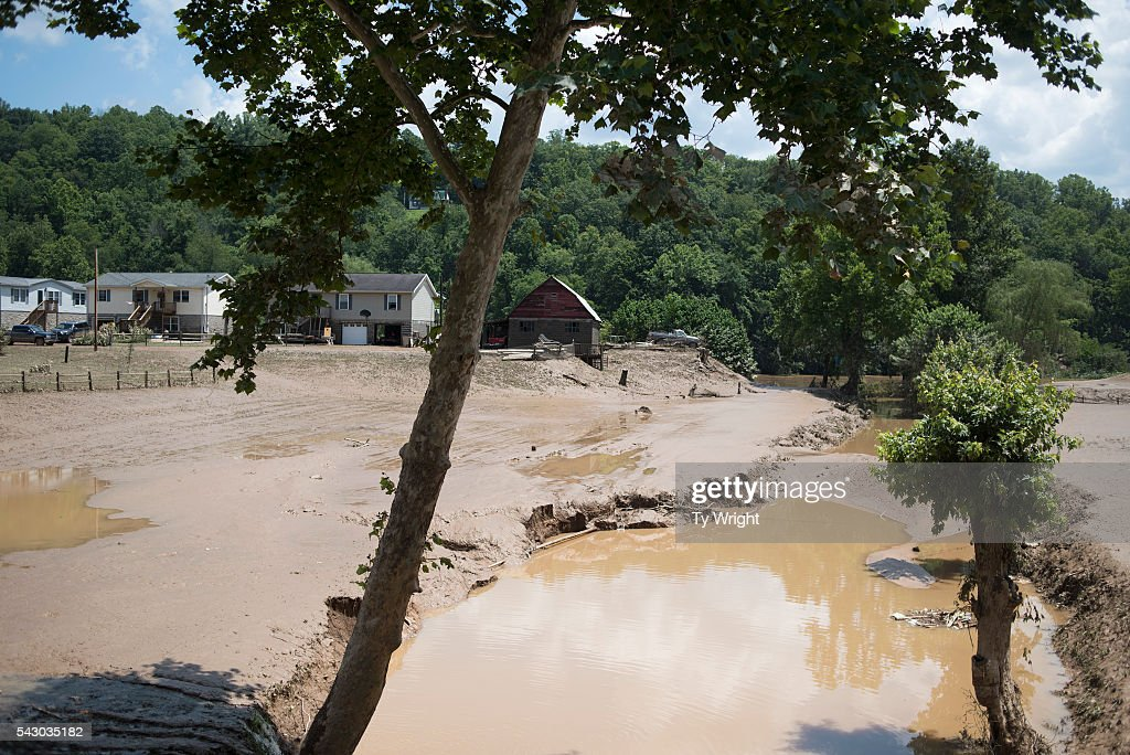 Farm land and crops are covered by mud from the flooding of the Elk River on June 25, 2016 in Falling Rock, West Virginia. The flooding of the Elk River claimed the lives of at least 23 people in West Virginia.