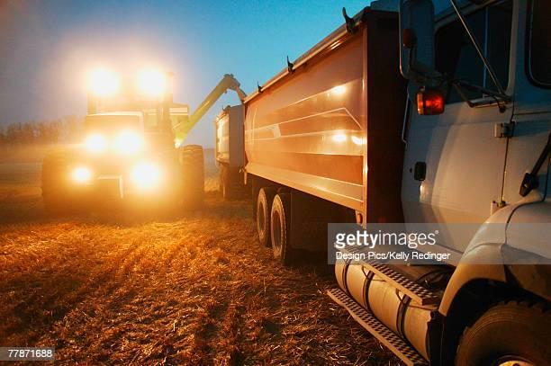 Farm machinery harvesting crop