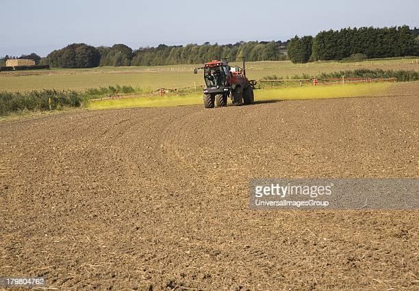 Farm machinery spraying Glyphosate herbicide on an arable field near Hollesley Suffolk England