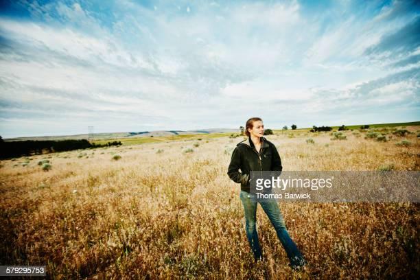 Farm owner standing in field on organic farm