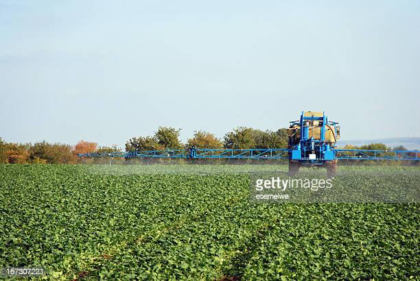 A farm sprayer distributes liquid chemicals to the crops