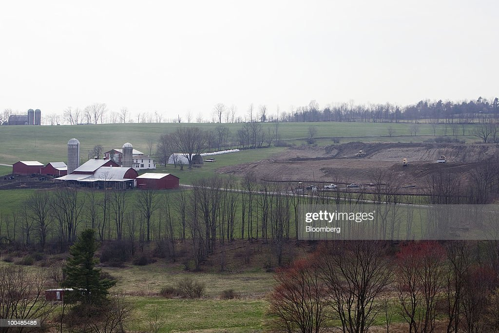 A farm stands near a site being prepared for natural gas drilling in Bradford County, Pennsylvania, U.S., on Tuesday, April 6, 2010. Companies are spending billions to dislodge natural gas from a band of shale-sedimentary rock called the Marcellus shale that underlies Pennsylvania, West Virginia and New York. The band of rock, so designated because it pokes through near a city of that name in northern New York, may contain 262 trillion cubic feet of recoverable gas, the U.S. Department of Energy estimates. Photographer: Daniel Acker/Bloomberg via Getty Images