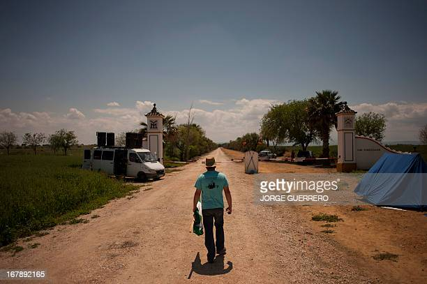 A farmer and activist of the Andalusian Union of Workers Union walks during a protest with occupation of ''Las Turquillas'' a 1200hectare plot of...