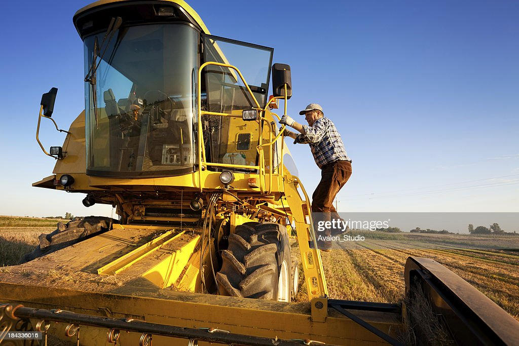 Farmer and Combine Harvester