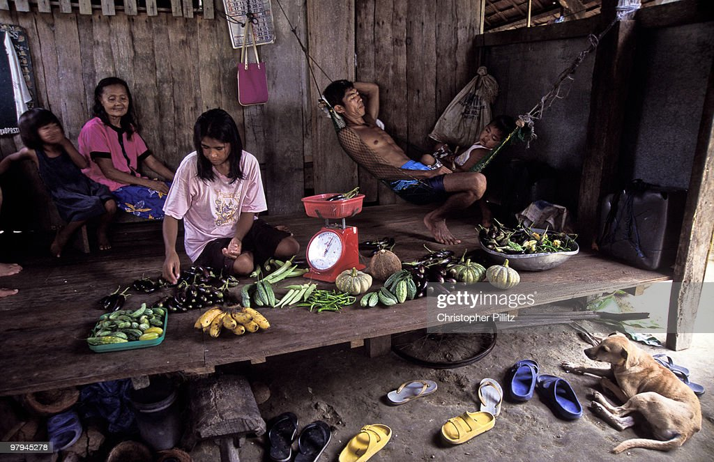 Farmer and family sell their produce : Stock Photo
