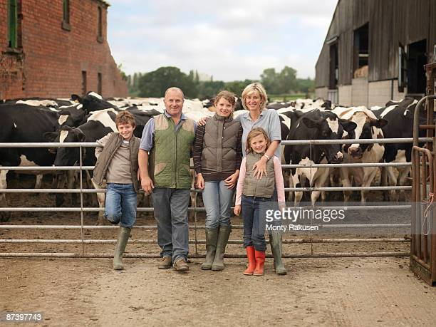 Farmer And Family With Cows
