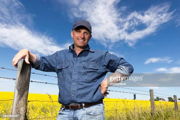 Farmer und Zaun