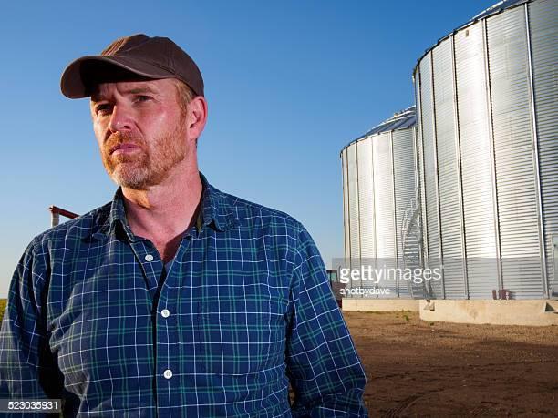 Farmer and Grain Silos