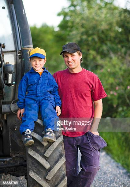 A farmer and his son by a tractor Sweden.