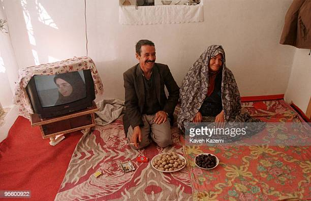A farmer and his wife in the living room of their home in Mamaghan near Tabriz in the northern province of Azerbaijan Iran 1st August 1996 In front...
