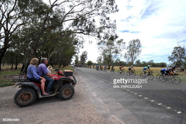 A farmer and his wife watch the peloton go past their front gate during stage three of the 2017 Herald Sun Tour cycling race in Melbourne on February...