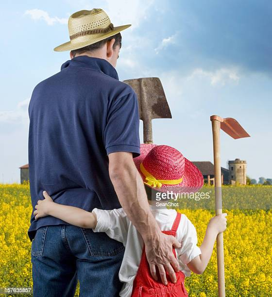 Farmer and Son against yellow field