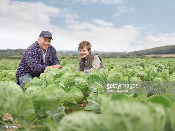 Farmer And Son In Crop Field