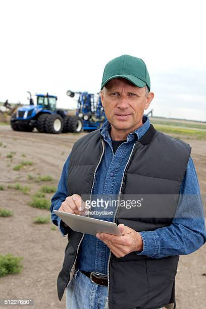 Farmer and Tablet Computer