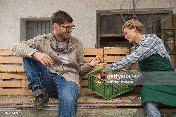 Farmer and worker taking rest and examine the apples c, Bavaria ,Germany