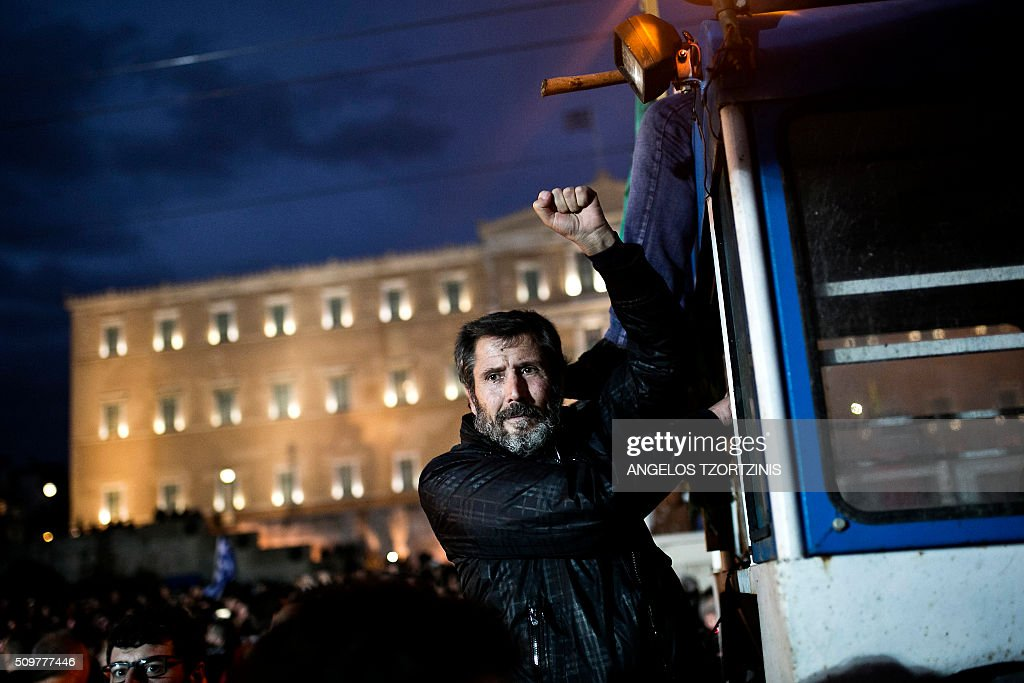 A farmer arrives on a tractor outside the Greek parliament during a protest against pension reform and tax issues, on February 12, 2016. Fears that Greece will exit the eurozone, a 'Grexit', could revive if Greek authorities do not come up with 'credible' reforms, notably on pensions, a senior IMF official said February 11, 2016. / AFP / ANGELOS TZORTZINIS