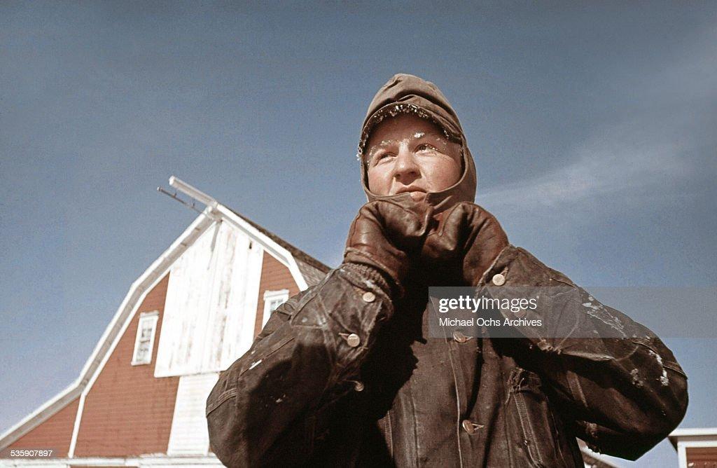 A farmer bundles up in the winter in North Dakota.