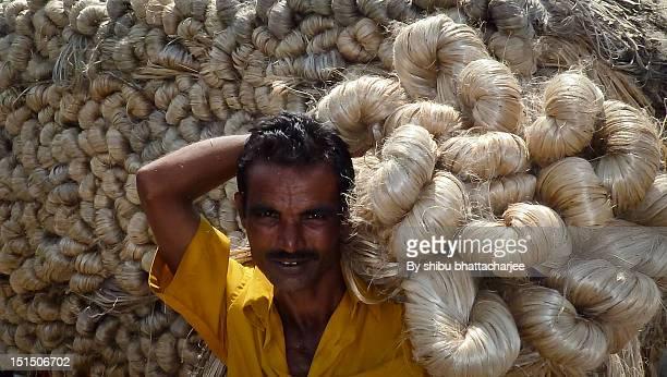 Farmer carrying jute