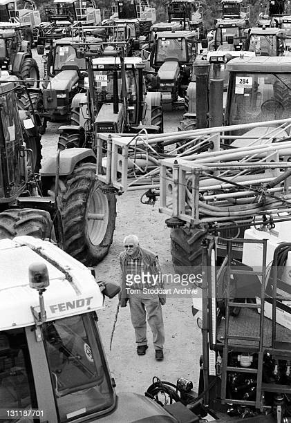 A farmer checks out the machinery on offer prior to the sixth international AGRAVIS auction held at Meppen in Emsland Germany 8000 visitors from...