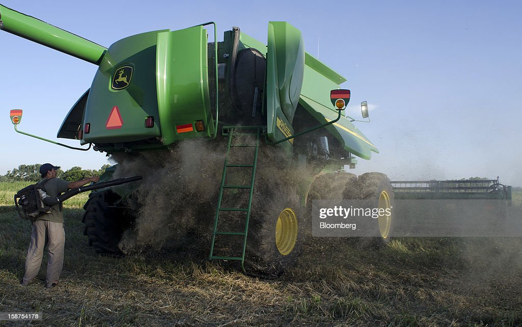 Farmer Claudio Lagomarsino cleans his John Deere combine after a day of harvesting wheat near Salto, Argentina, on Monday, Dec. 24, 2012. Argentina, South America's largest wheat producer, will have a current crop as low as 9 million tons because of excess rain, heat and plant diseases, a board director of wheat producers association Aaprotrigo said. Photographer: Diego Giudice/Bloomberg via Getty Images