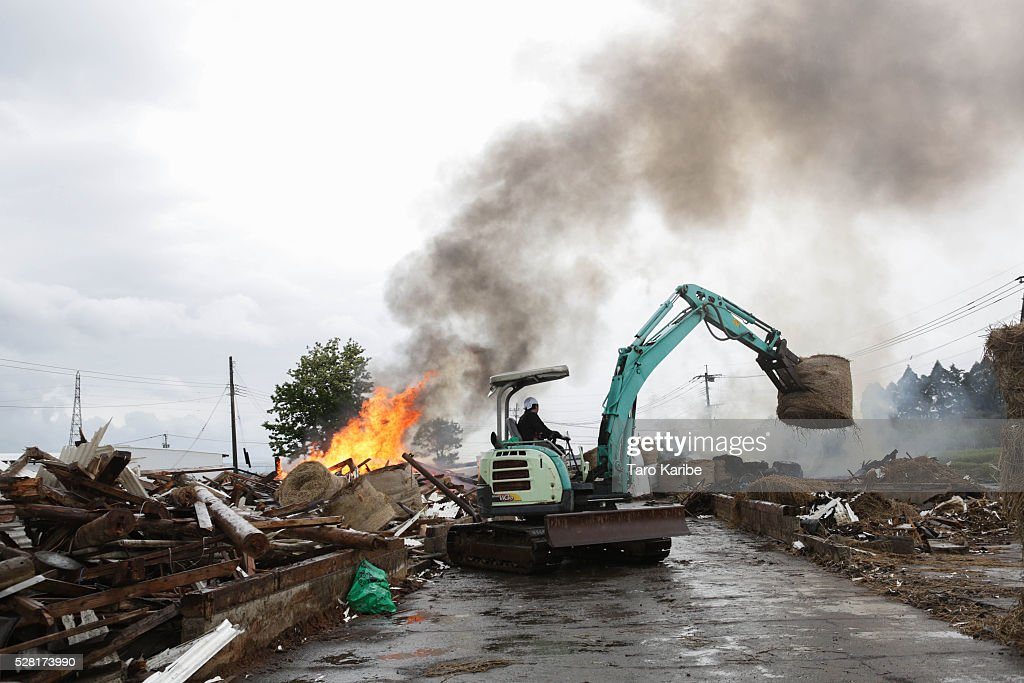 A farmer clears the rubble of his destroyed warehouse on May 4, 2016 in Kumamoto, Japan. Since twin earthquakes jolted Kumamoto on April 14 and 16, over 1,200 aftershocks have hit the area. Kumamoto prefecture calculated the amount of damage to agriculture, forestry and fisheries to be roughly 102 billion Yen ($957 million USD).