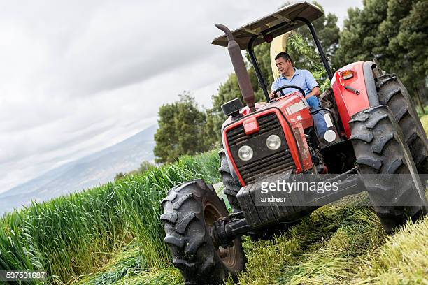 Farmer driving a tractor at the farm