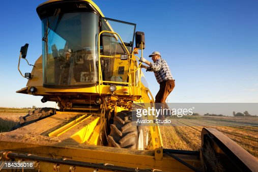 Farmer enters the combine harvester