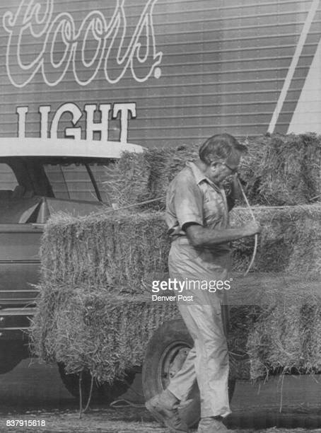 Farmer George O'Kelley of Athens Georgia ties down 50 bales of Colorado hay recently This shipment is the first of 1000 tons of hay donated by...