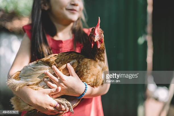Farmer girl with hen